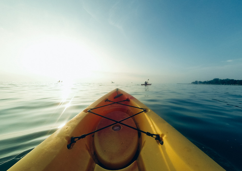 view from yellow kayak on water