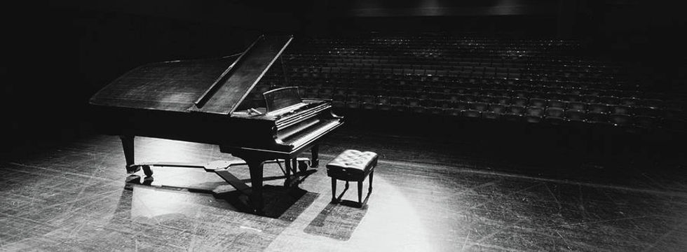 grand-piano-on-a-concert-hall-stage-pano