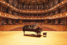 piano-on-stage-in-empty-theater-ivan-hun