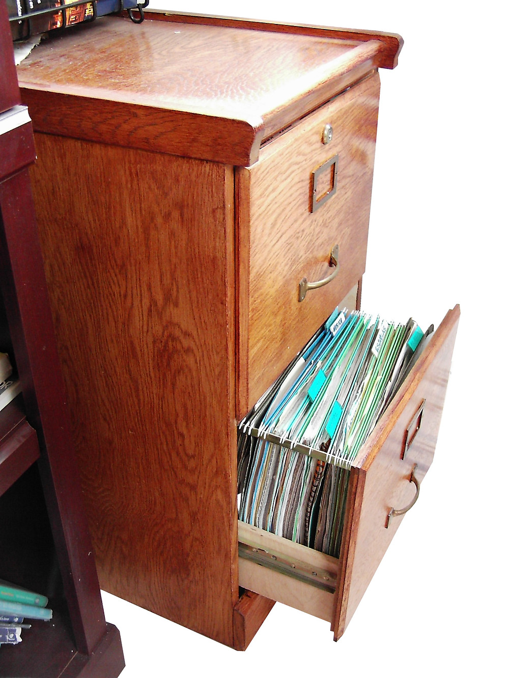 Efficient Filing Systems 101 - Wooden filing cabinet with drawer open