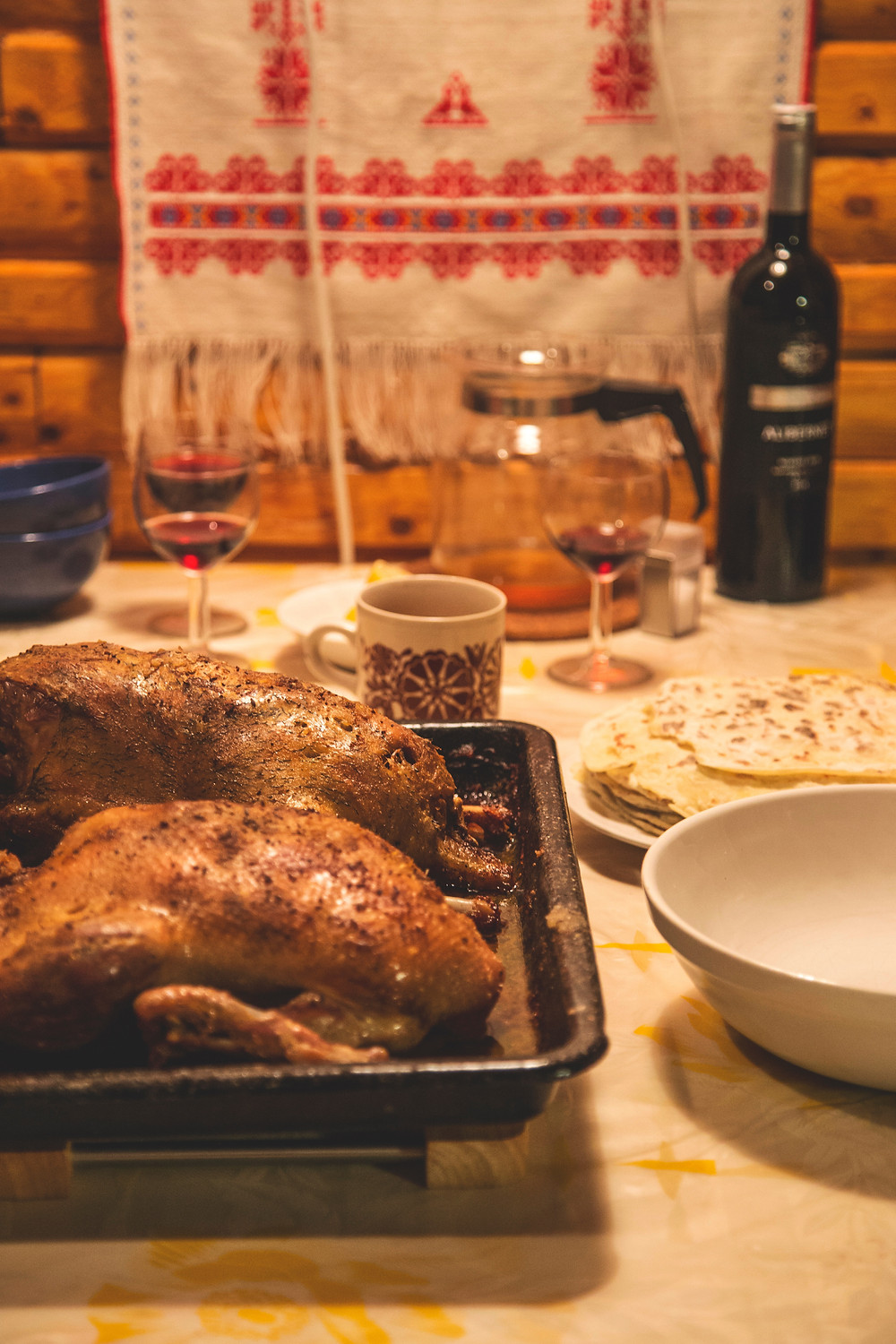 Get Organized for Thanksgiving - Turkey on a table with wine glasses