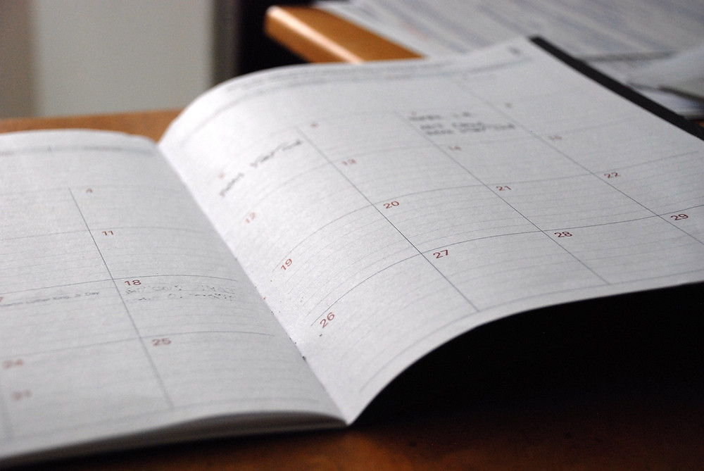 A paper calendar is one way getting organized can help you save time and money