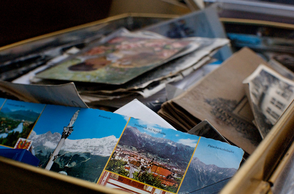 Reduce Your Vacation Clutter - Send Yourself a Vacation Postcard: box of vintage photos and postcards