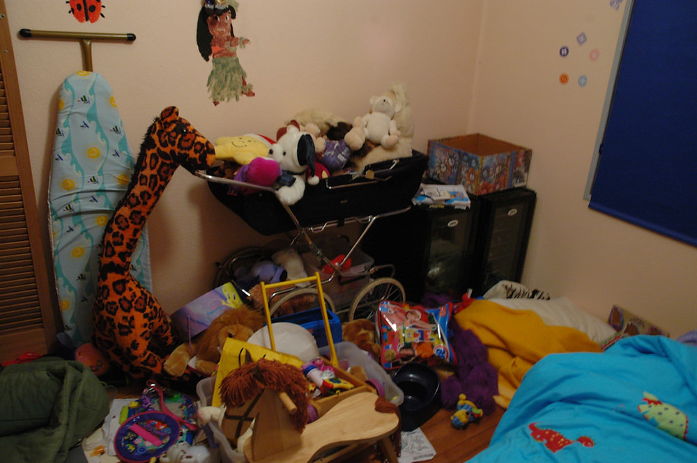 "What's the Difference Between Hoarding and Being Messy? - Photo of messy child's room - ""Before"" <a  data-cke-saved-href=""https://creativecommons.org/licenses/by/2.0/"" href=""https://creativecommons.org/licenses/by/2.0/"">CC 2.0</a> by <a  data-cke-saved-href=""https://www.flickr.com/photos/gemsling/278243753/"" href=""https://www.flickr.com/photos/gemsling/278243753/"">Gemsling</a> (Flickr)"