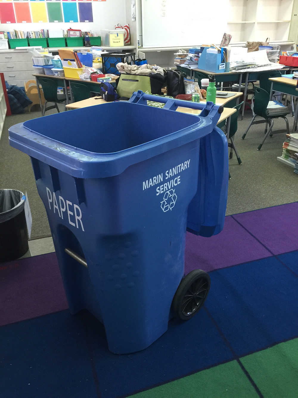 OLWH: Back to School - Organizing a Classroom / A giant blue paper recycling bin from the Marin Sanitary Service sits in the classroom, ready to receive loads of outdated papers for recycling