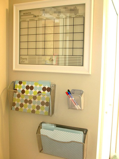 Taste of My Own Medicine: Top 10 Things to Get Ready for School - Organized home command center with acrylic dry-erase calendar, metal file organizers with folders inside, and a basket for dry-erase markers