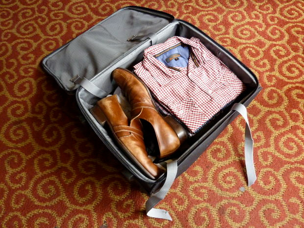 10 Tips for Stress-Free Packing and Traveling - Men's Suitcase with shoes at the bottom