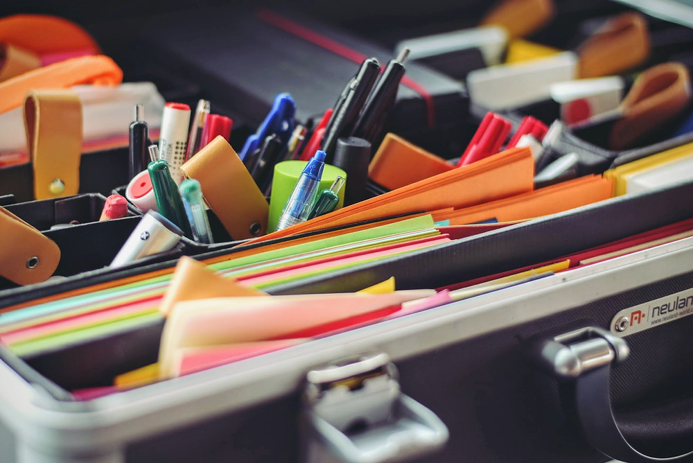 Spring Clean Your Home Office - Photo of a trunk with organized files, pens, pencils, highlighters and other stationery, and other less-frequenrly used office items