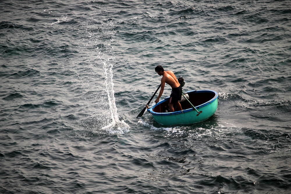 The Businessman and the Fisherman - Fisherman in a small round boat