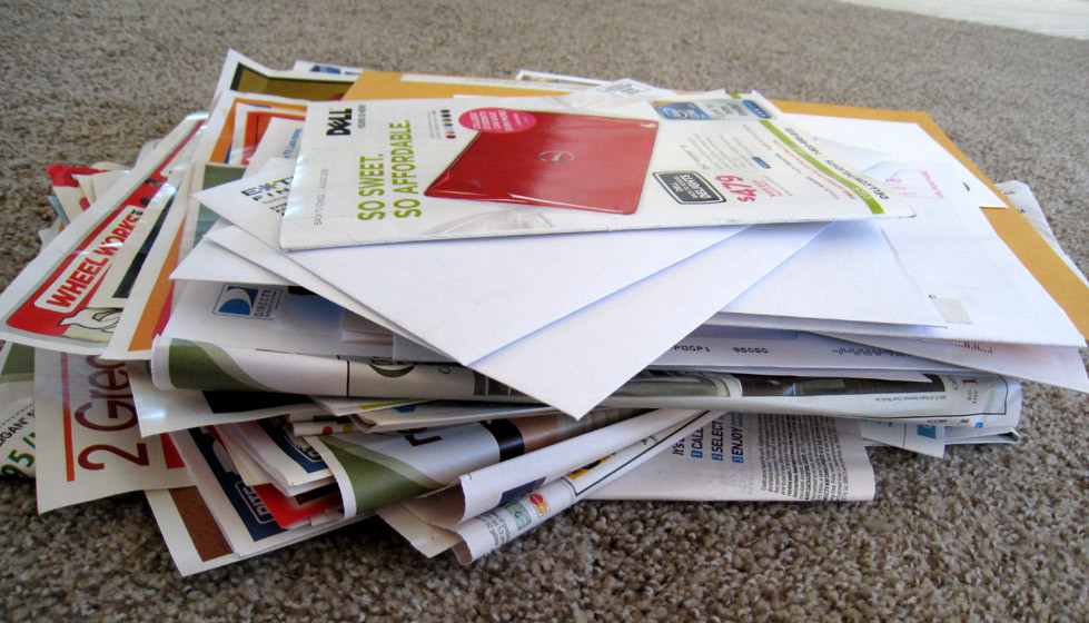 Pile of junk mail, newspaper