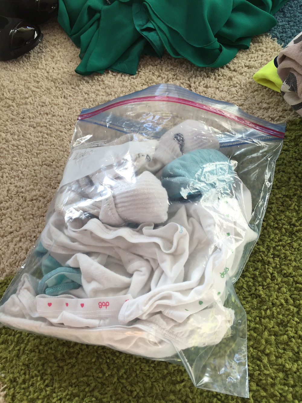 Traveling with Kids - Bundle like clothes together and put them in a plastic zip-top bag
