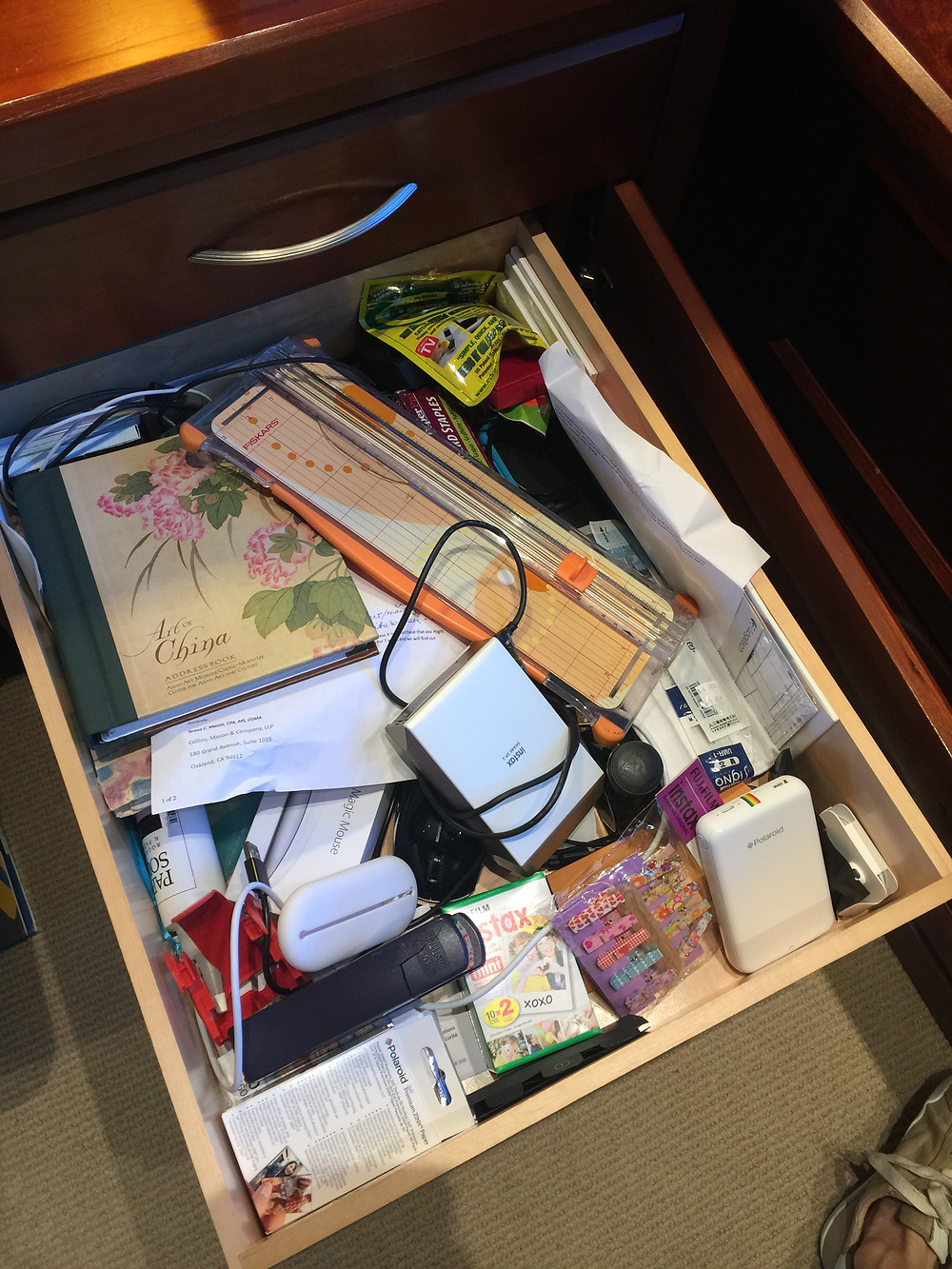 OLWH: Taking Down the Junk Drawer: 3 Tips - photo of a messy junk drawer with assorted items piled on top of one another