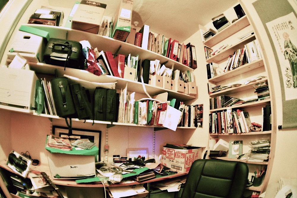Organizing Mistakes - I Love Clutter (Creative Commons Share Alike 2.0) (c) Sin Designs on Flickr - cluttered office with several filled boxes, magazines holders, and folders in shelves and strewn on a desktop