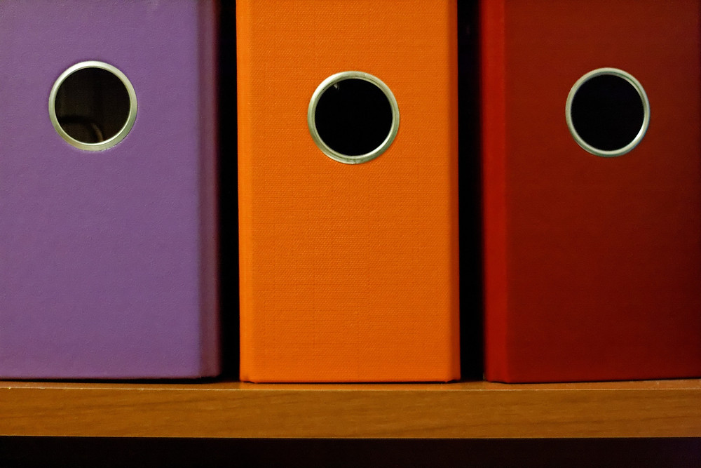 4 Common Organizing Mistakes and How to Avoid Them - Too many organizing products - Colorful magazine holders. Just having organizing products does not make you more organized. They have to be useful and not contribute to more clutter.