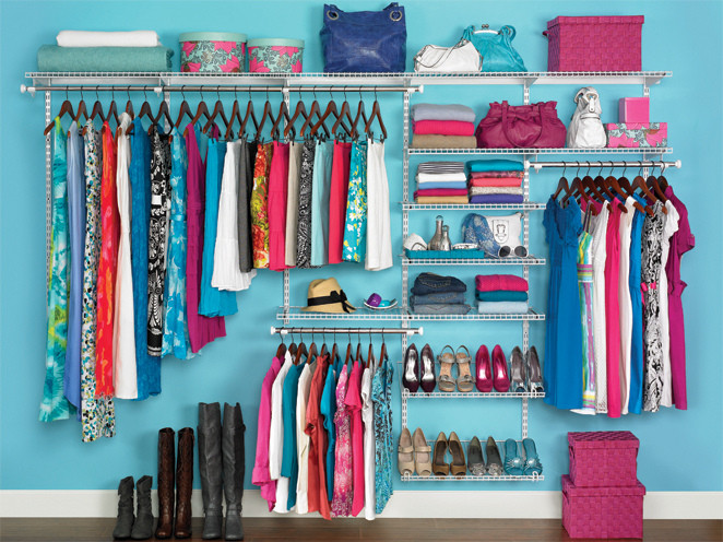Don't Complicate Your Organizing Systems: 4 Easy Tips - Purchase organizing items that appeal to you-- pick one style and stick to it. Photo of organized closet with items hanging off dark wooden hangers on a white metal wall-mounted shelving system, with items in turquoise hat boxes or magenta square woven baskets.