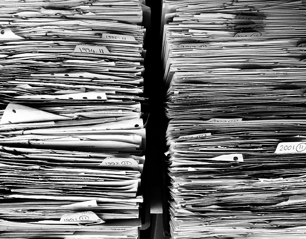 4 Common Organizing Mistakes and How to Avoid Them - Overly complicated organizing systems - Two large stacks of folders stuffed with papers. How far back do you really need to go with your paperwork? How detailed does your system need to be? It should be EFFECTIVE, bottom line.