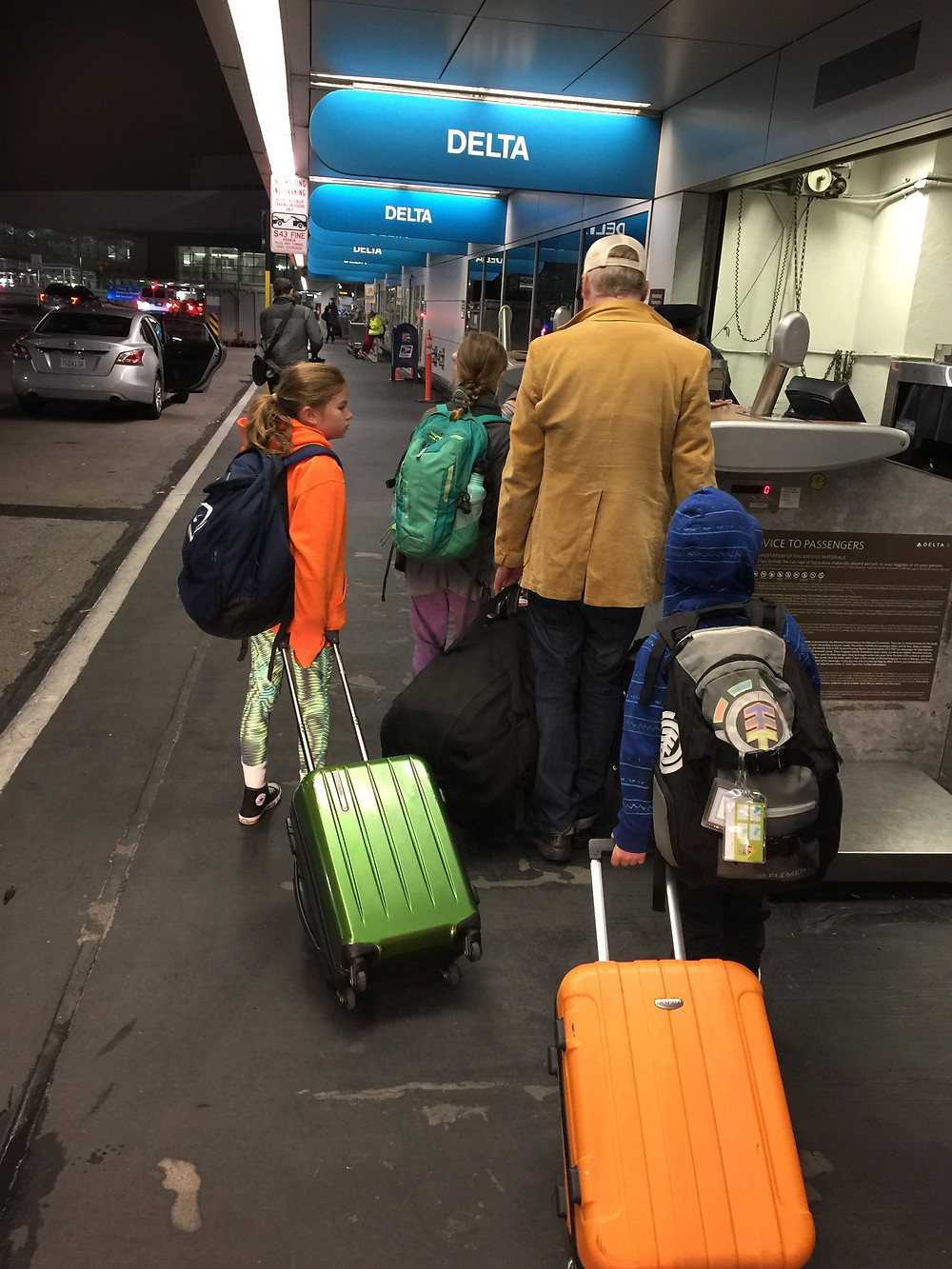 Traveling with Kids - Zip it up and go; avoid checked bag fees by doing curbside check-in and bringing carry-on suitcases to the gate!