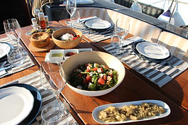 """<img src=""""lunch onboard Aiolis.png"""" alt=""""A set table on the deck of a sailing boat"""">"""