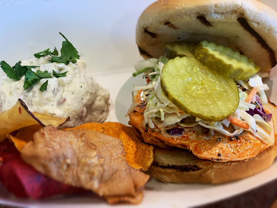 Grilled Chicken Burger with Pickles, cold slaw, sweet potato chips and potato salad, healthy fast fo