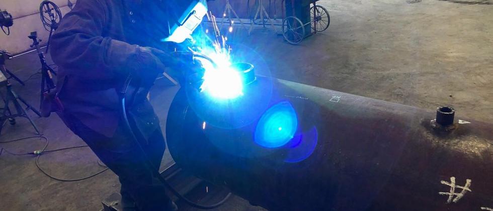 Welder at Lnl Fabrication Warehouse on J