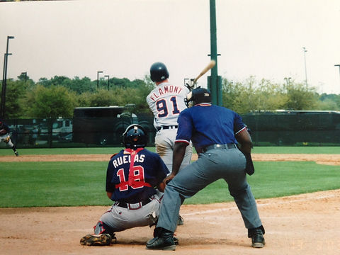 Sam Flamont drives a double into the gap against the Altlanta Braves in a Spring Training Game.  Sam Flamont is now an Author, Speaker, and Multi-Family Real Estate Investor