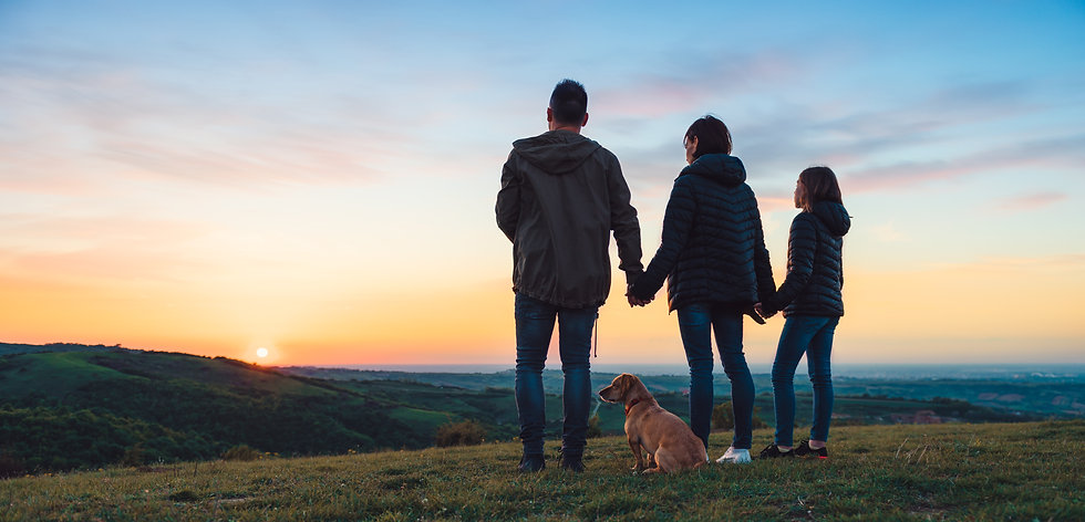 family-with-dog-embracing-while-standing
