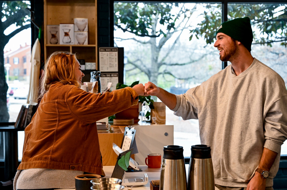 Lead barista Christian Brook greets a customer ordering coffee at 1000 Faces in downtown Athens, Georgia, on Feb. 5, 2020.