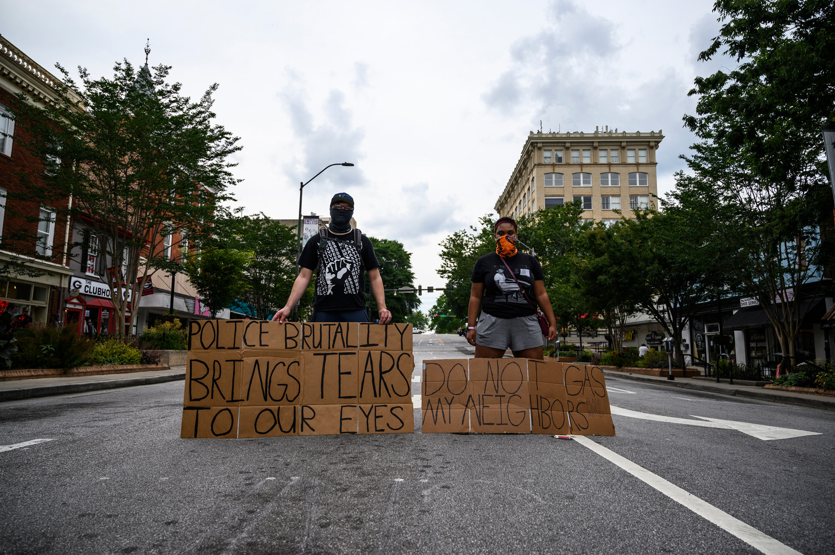 Protesters hold signs, kneel every hour and listen to music on Saturday, June 6, 2020 in Athens, Georgia. These protesters chose to stay downtown after a rally organized by the Athens Anti-Discrimination Movement ended. This marks the seventh consecutive day of protests in Athens that join with  protests worldwide that call for racial justice and an end to police violence against minorities. The National Guard, GBI officers and Athens-Clarke County police were all on scene or staged nearby.