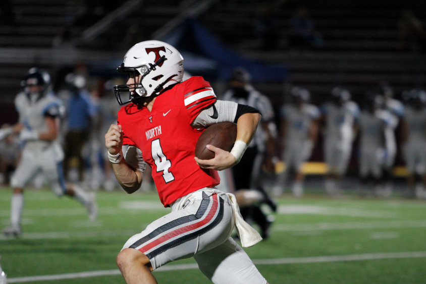 North Oconee Titans quarterback Bubba Chandler runs with the ball on Friday, Sept. 18, 2020. The Titans lost to the Cambridge Bears 34-10.