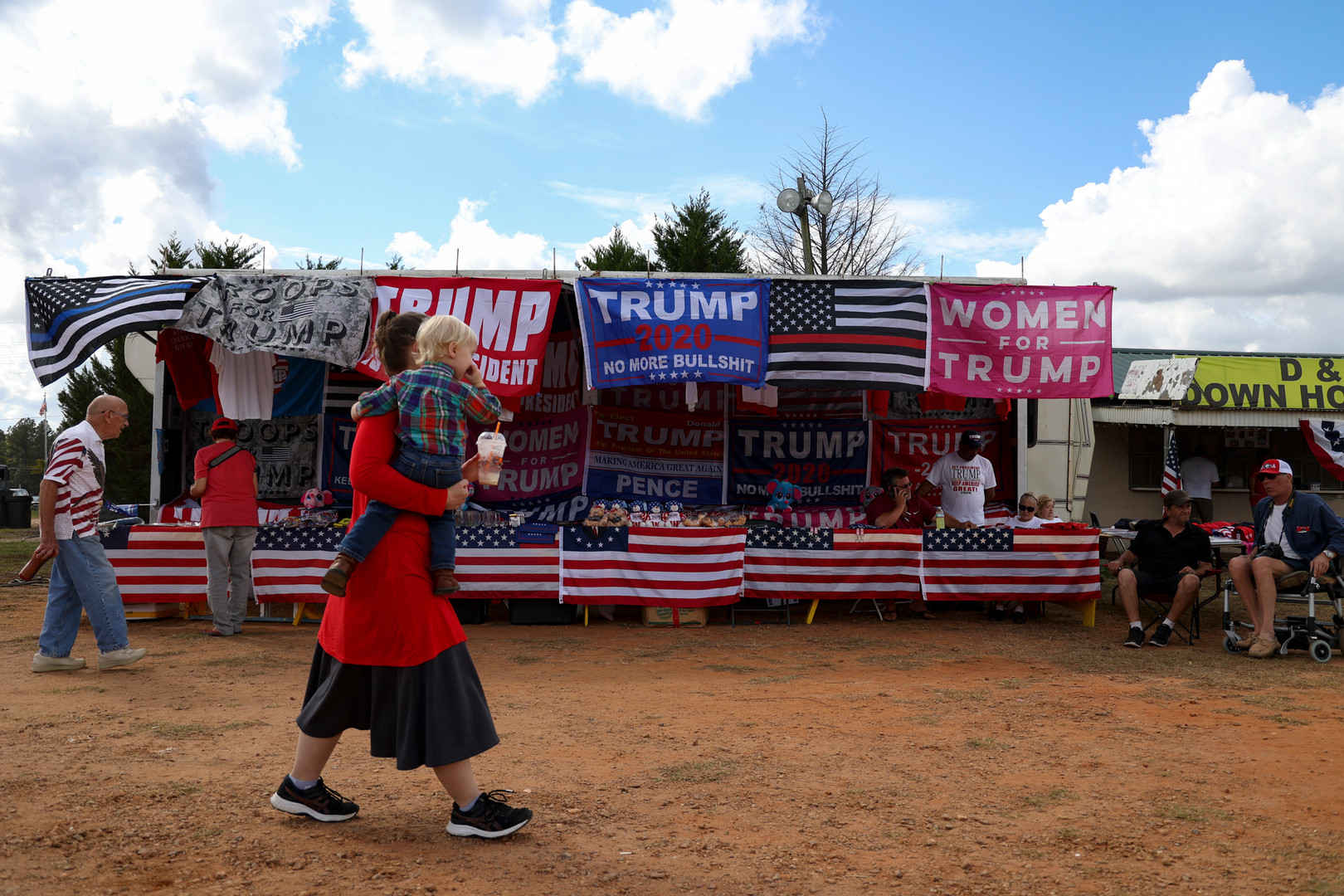 """People gather at the Athens Fairgrounds in Athens, Georgia on Saturday, Oct. 24, 2020 for an """"Athens for America"""" event. The event was organized by a group of conservative residents and included food, vendors, speakers and live music."""
