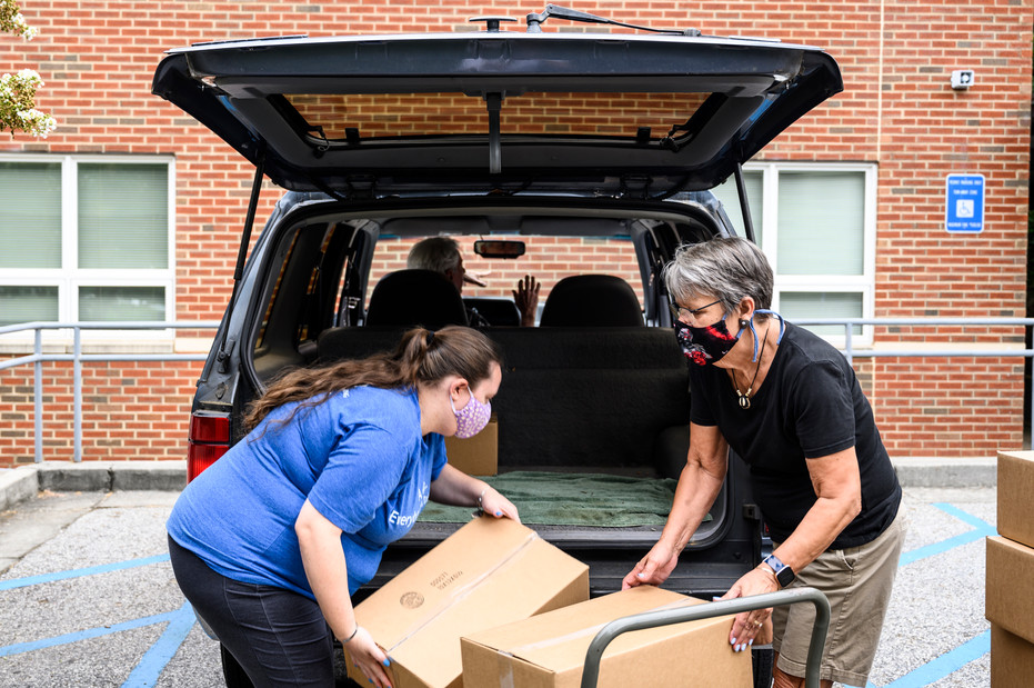Staff at Athens Community Council on Aging load volunteers' cars with meals for their Meals on Wheels routes in Athens, Georgia on Wednesday, July 29, 2020.