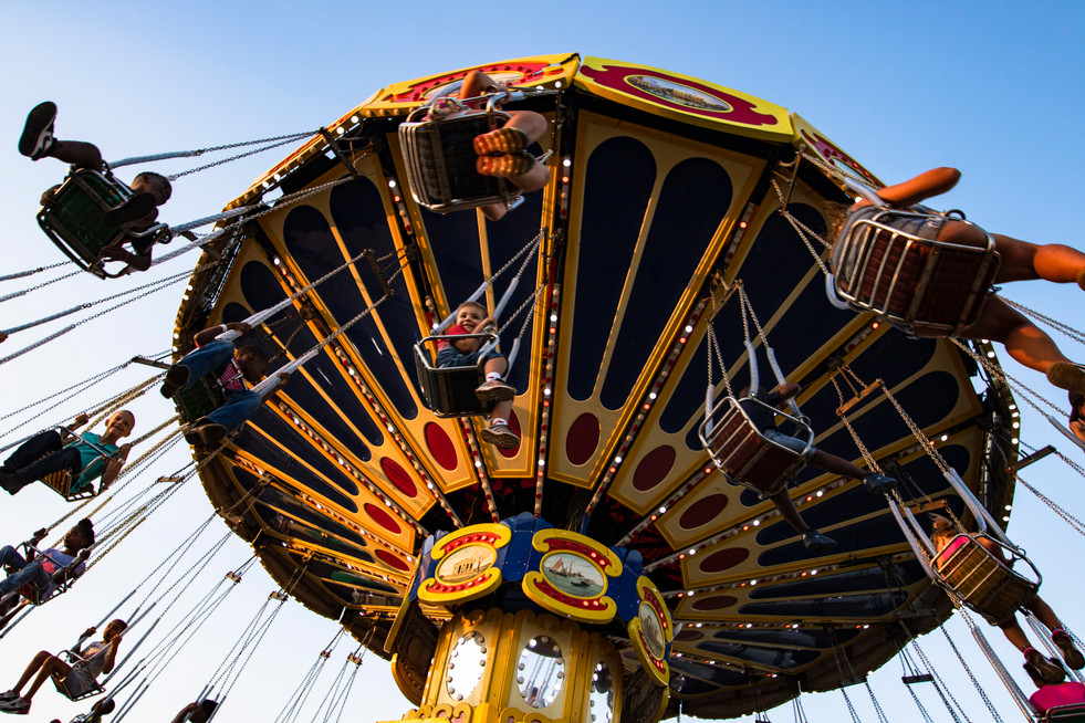 Children fly through the air in swings at the Georgia National Fair in Perry, Georgia on Saturday, Oct. 5, 2019. The 30th anniversary of the fair offered food, rides, games, live entertainment, livestock events, and agriculture contests to 565,533 guests, setting a new attendance record.
