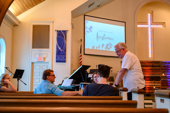 Pastor Phil Wages talks with the Bailey family, some of the only people filling the pews at Winterville First Baptist Church in Winterville, Georgia on Sunday, May 24, 2020. On April 5, 2020, the church stopped meeting in person and switched to live streamed services.