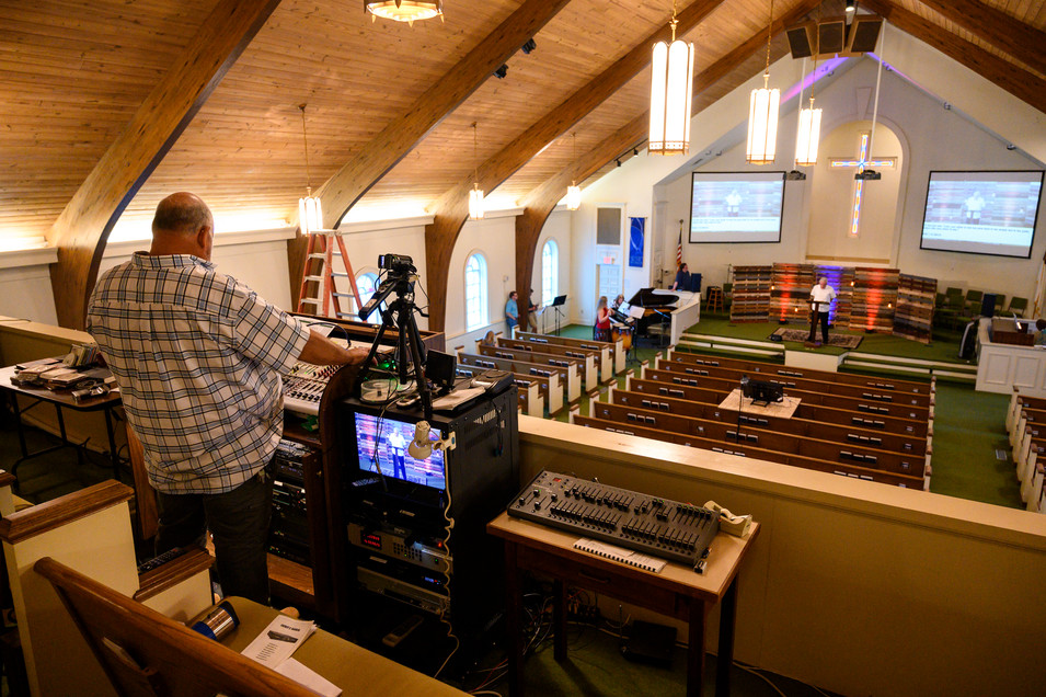 Tim Bramlett operates the soundboard and video equipment at Winterville First Baptist Church in Winterville, Georgia on Sunday, May 24, 2020. The church used to upload audio files to their website each week, but they have expanded to produce live streamed services each week.
