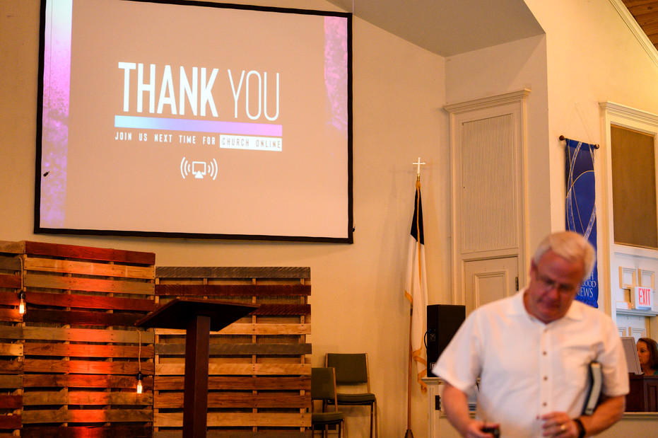 Pastor Phil Wages packs up to leave after delivering a message via live stream at Winterville First Baptist Church in Winterville, Georgia on Sunday, May 24, 2020. Wages said preaching to a camera is very different than what he's used to, as he doesn't have the audience feedback and connection that he normally would with a room full of churchgoers.