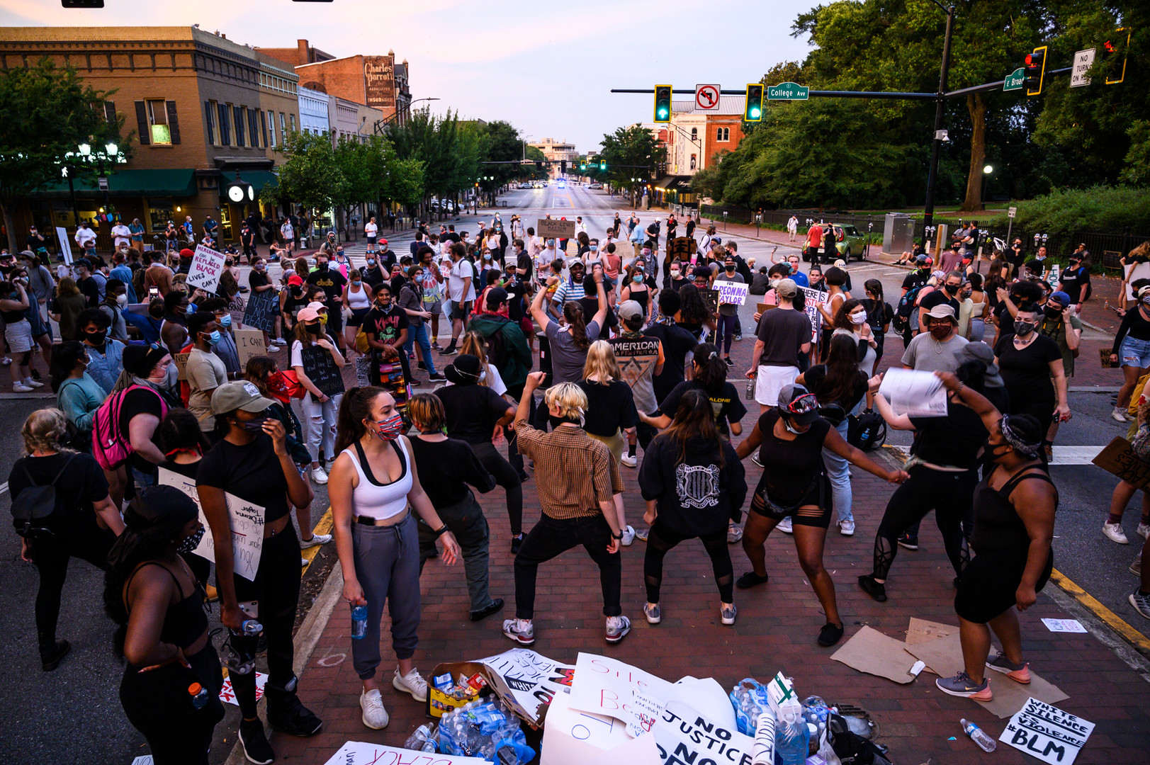 A huge dance party breaks out among protesters in the intersection of Broad Street and College Avenue on Saturday, June 7, 2020 in Athens, Georgia. Several hundred protesters chose to stay downtown after the official rally ended, and the evening ended with dancing and games in the street as activists asked protesters to return home before midnight.