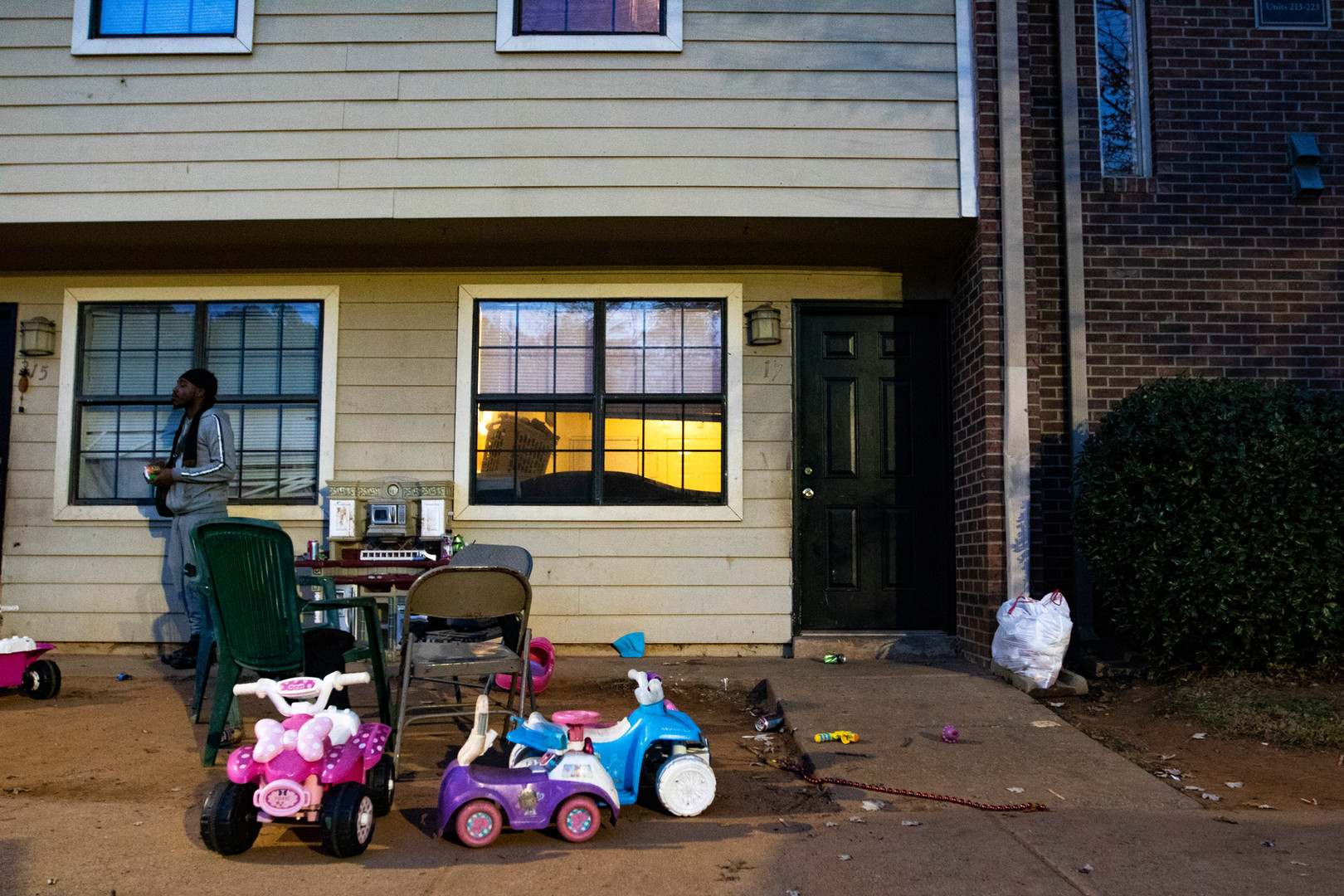 Childrens' toys are abandoned for the night outside of Renata Hailey's home in Athens, Georgia on Thursday, Nov. 21, 2019. Hailey lives with her five children in a subsidized apartment complex where unresolved maintence issues have created unsafe living conditions for her family. Due to untreated mold in the carpets, walls, and floors, all of her children require breathing treatments. Exposed wires in her dishwasher pose an electrical safety threat to the infants in her home and render the dishwasher unusable. Frequent fights and violence in the neighborhood prevent her from allowing her children to play far from the front door. Hailey says she feels like she is living in the projects, not a subsidized townhome.