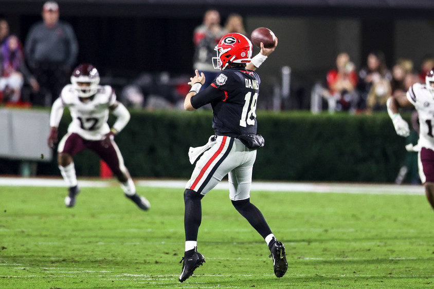 UGA quarterback JT Daniels throws the ball in the UGA versus Mississippi State football game in Athens, Georgia on Saturday, Nov. 21, 2020. At halftime, the game was tied 17-17.
