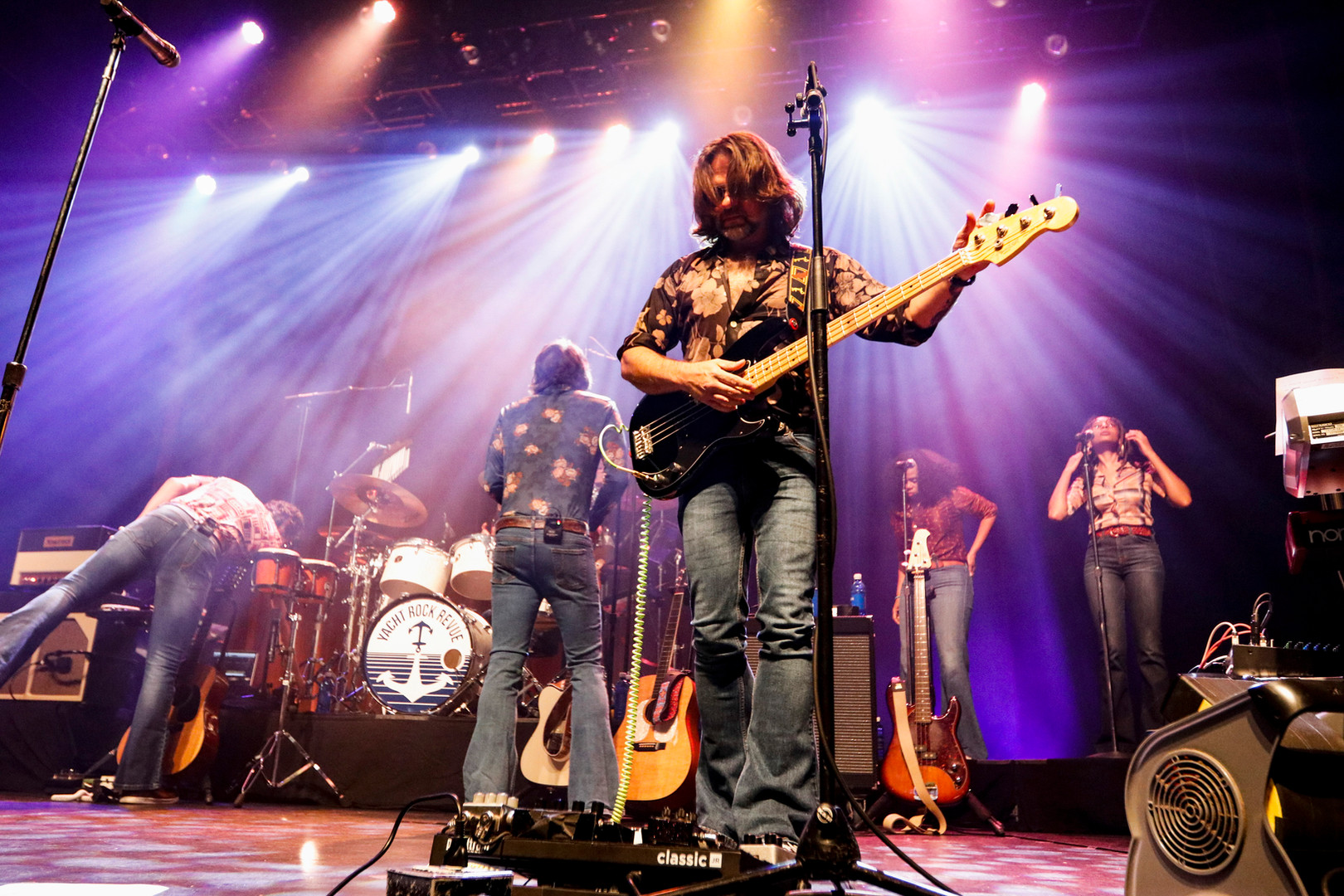 Yacht Rock Revue tunes instruments between songs while playing at the sold out Georgia Theater in Athens, Georgia on Friday, Sept. 6, 2019. The band brings back the '70s and '80s with covers of hit songs, sunglasses at night, bell-bottom jeans, and some original songs that keep to the sing-along, soft rock genre of the era.
