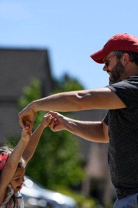 Matthew Perkins twirls his daughter, Emmy, 4, in their front yard in Athens, Georgia on Saturday, April 23, 2020.