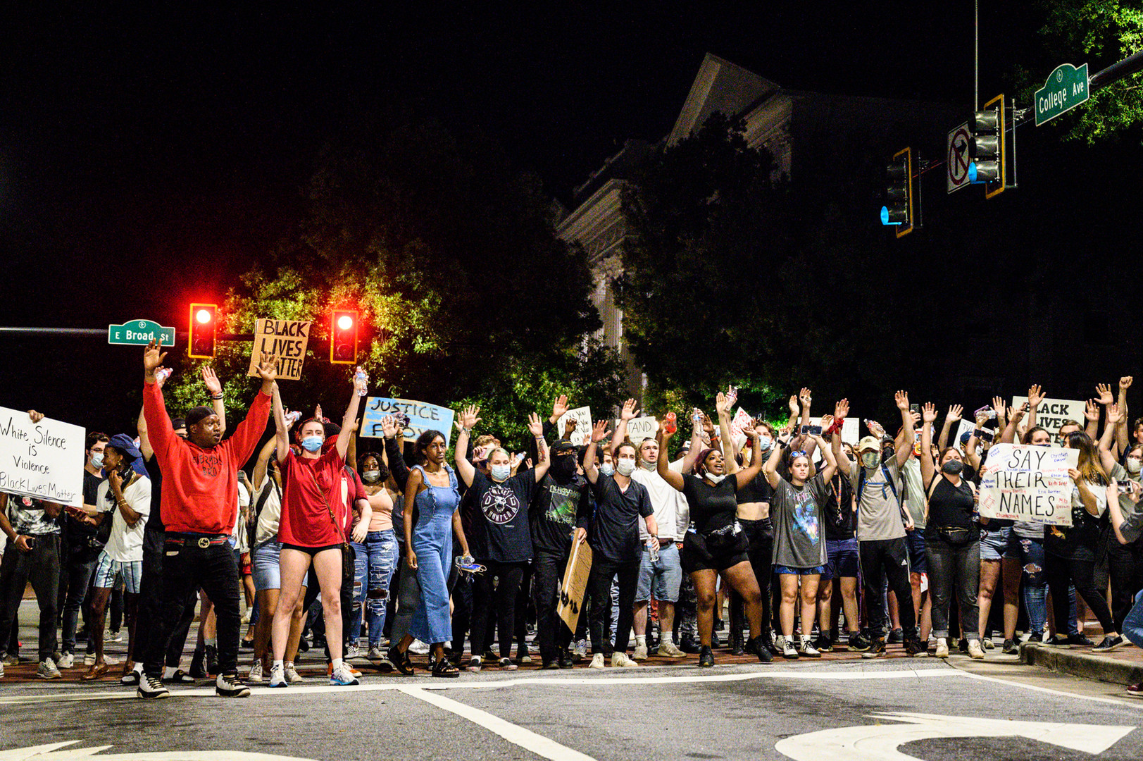 """Protestors shout """"hands up; don't shoot"""" in Athens, Georgia on Sunday, May 31, 2020. Two non-violent protests started in the afternoon, both calling for racial justice and an end to police brutality following the death of George Floyd in Minneapolis six days earlier. As the evening progressed, police forces surrounded the intersection with armored trucks, officers in riot gear and police cars."""