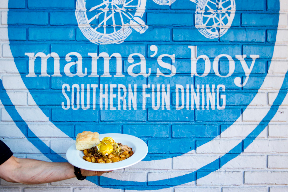Mama's Boy's general manager holds their popular pulled pork and potato hash outside the restaurant in Athens, Georgia on Tuesday, Sept. 17, 2019. The breakfast and brunch restaurant has been an Athens staple since 2006 and has been featured in several magazines including Southern Living and Sports Illustrated.