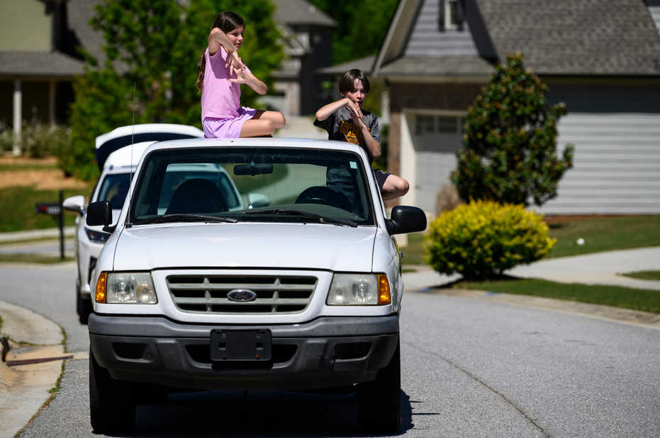 Declan, 10, and Charlotte, 7, dance on the truck that has become a mobile dance party for their Athens, Georgia neighborhood.