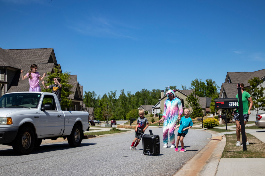 """Joey and Ashley perform a dance routine to """"U Can't Touch This"""" with their kids, Lana, 6, and Clark, 4, for their neighbors in Athens, Georgia on Saturday, April 23, 2020."""