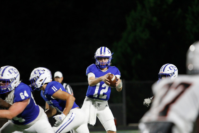 Oconee County Warriors quarterback Tate Yancey  prepares to hand the ball to a teammate on Friday, Oct. 23, 2020. The Warriors beat the Hart County Bulldogs 30-7.