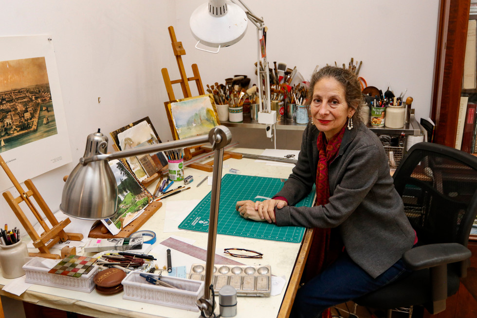 Jill Biskin poses for a portrait in her at-home studio in Athens, Georgia on Monday, Nov. 4, 2019. Biskin moved to Athens from New York City 22 years ago and spent one year painting the mural inside of The Classic Center downtown.