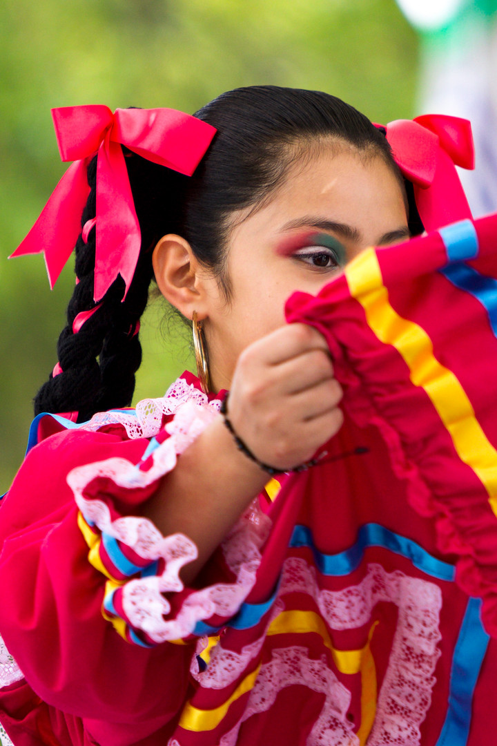 Yasmin Reyna performs a traditional Mexican dance as part of Athens' Latinxfest in downtown Athens, Georgia on Saturday, Sept. 28, 2019. Reyna is a dancer with Tonalli, a local dance group that celebrates traditional Mexican dance.