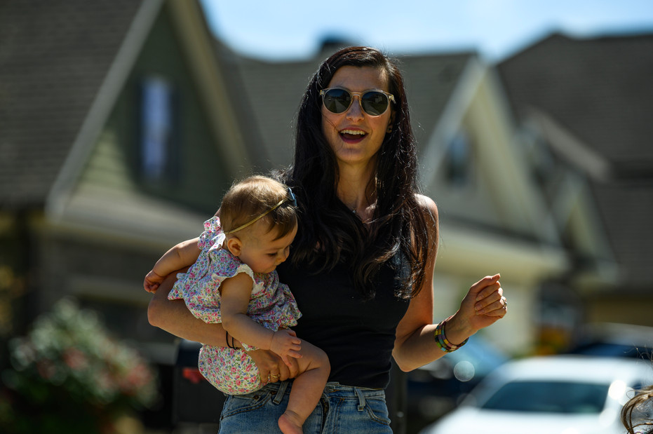Laura Perkins dances with her seven-month-old daughter Violet as part of a socially distant neighborhood dance party in Athens, Georgia on Saturday, April 23, 2020.