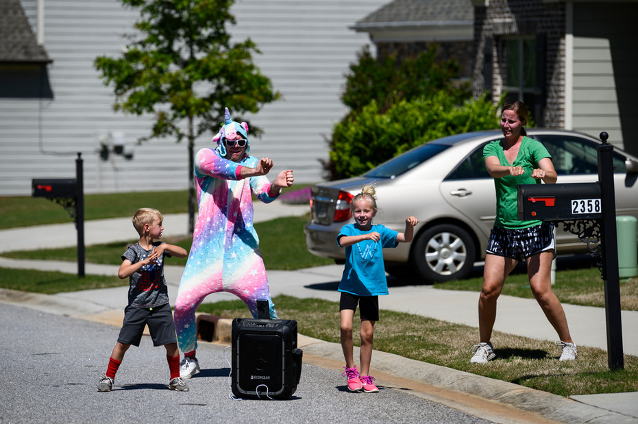Joey Stewart dances with his children as part of a weekly Saturday afternoon mobile dance party in Athens, Georgia  on Saturday, April 23, 2020.