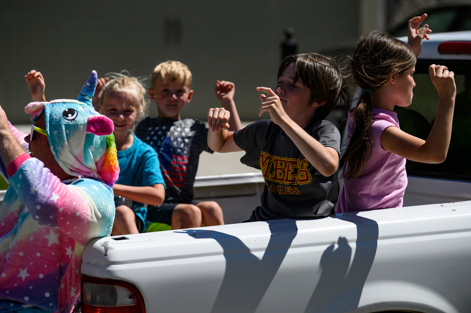 Neighborhood kids ride in the Stewarts' truck for a drive-by dance party in Athens, Georgia on Saturday, April 23, 2020.